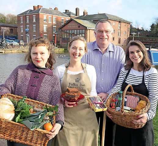Meet the producers: Lisa (left) and Katie (right) with some of the producers working hard to deliver tasty food and drink to the Chester Food Assembly   Photo: Courtesy of Cheshire Life