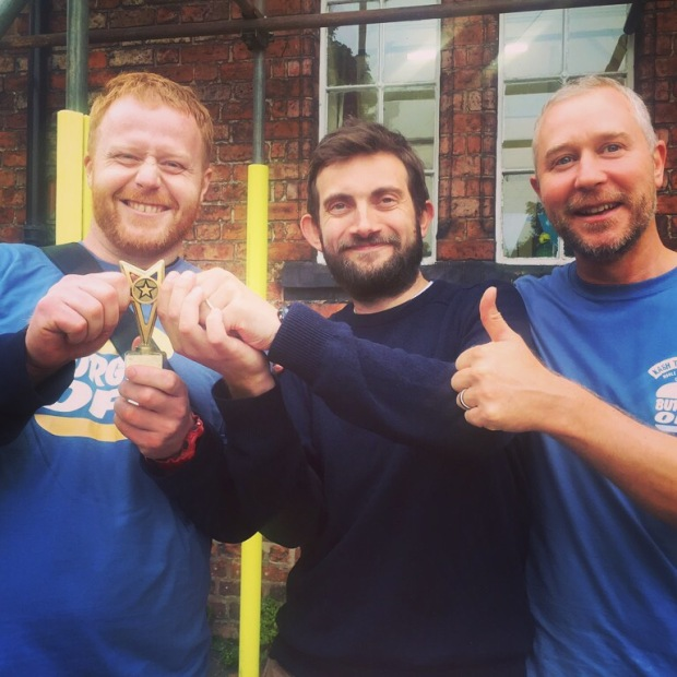 Dom and Ben from Joseph Benjamin celebrate with #BurgerOff co founder and organiser Andy Tabberer Photo: Angela Ferguson